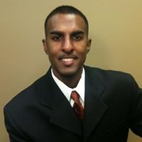 Krishan Oliver with REALM Real Estate Professionals