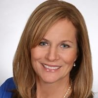 Teresa Dennison-Long and Foster Real Estate