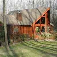 NORTH AMERICAN WHOLESALE CEDAR LOG HOMES