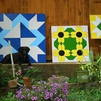 Bear Creek Lodge Chainsaw Carvings and Barn Quilts