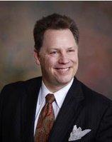 James E. Leuenberger, PC