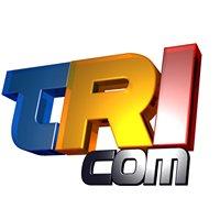 TRI COM